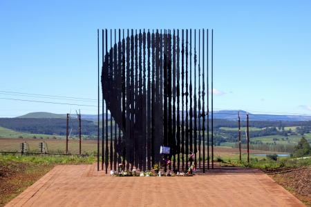 nelson: Howick, KwaZulu-Natal, South Africa - 30 December 2013: Metal sculpture of Nelson Mandela at the site where he was arrested in 1962 by the apartheid government.