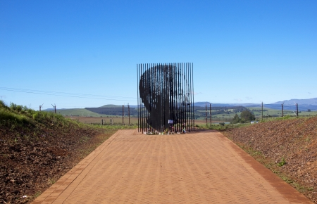 howick: Howick, KwaZulu-Natal, South Africa - 30 December 2013: Metal sculpture of Nelson Mandela at the site where he was arrested in 1962 by the apartheid government.