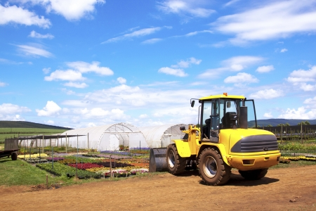 utilized: payloader utilized for heavy lifting at commercial horticultural nursery