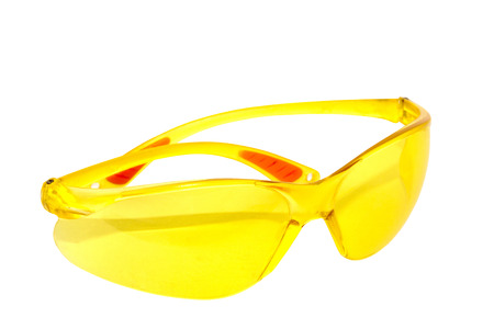 tinted glasses: pair of bright yellow plastic protective glasses