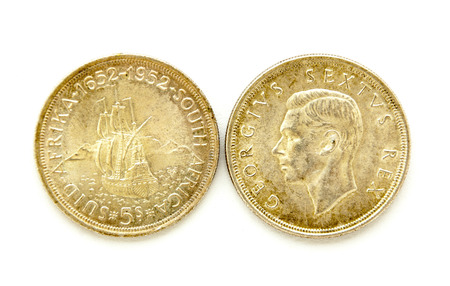 shilling: front and back of vintage south african five shilling coins