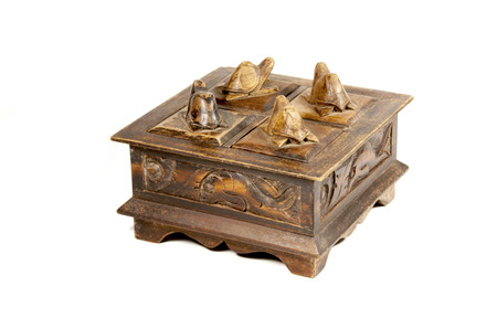 hand carved: vintage wooded hand carved jewelry box with patterns and turtles Stock Photo