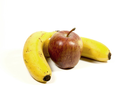 bannana: two yellow ripe bananas and red apple on white background Stock Photo