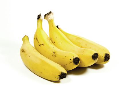 bannana: four isolated yellow ripe bananas on white