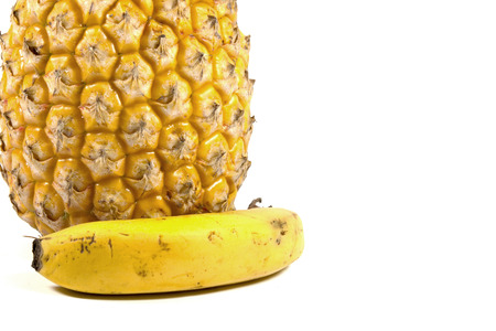 bannana: isolated fresh pineapple and ripe yellow bannana on white