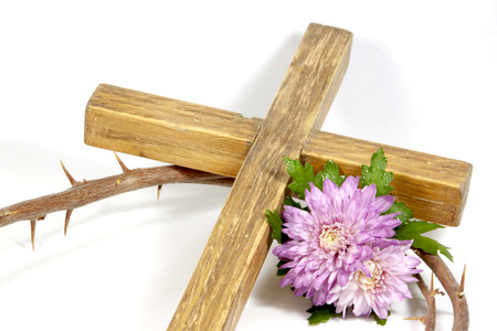 wooden cross crown of thorns with chrysanthnum photo