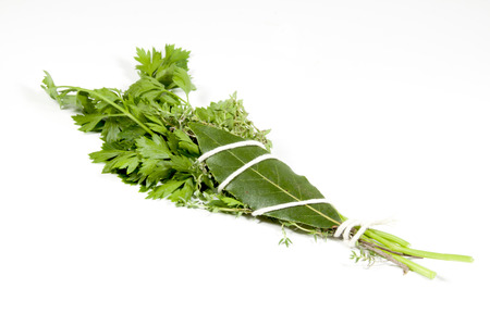 studio shot of traditional bouquet garni made up of parsley thyme and bay leaf