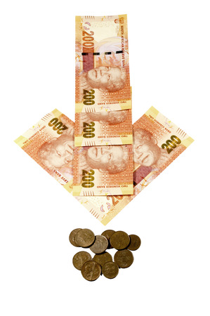 rand: concept arrow of South African bank notes showing rand exchange rate depreciating Stock Photo