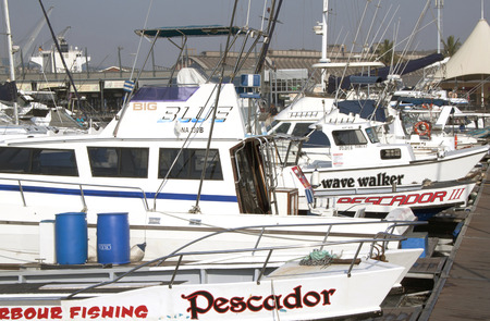DURBAN, SOUTH AFRICA - AUGUST 8, 2013 : Fishing Boats and yachts moored at Wilsons Wharf in Durban South Africa