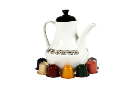 Isolated colorful coffee pods and pot on white photo