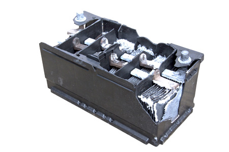 Motor vehicle battery destroyed by internal explosion Stock Photo