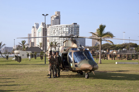 personel: DURBAN, SOUTH AFRICA - MARCH 22, 2014: South African Military helicopter lands on beach front in Durban South Africa. Helicopter is taking part in the Land Sea and Air Festival in Durban
