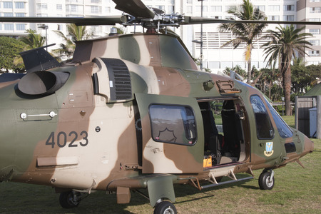 DURBAN, SOUTH AFRICA - MARCH 22, 2014: South African Military helicopter lands on beach front in Durban South Africa. Helicopter is taking part in the Land Sea and Air Festival in Durban