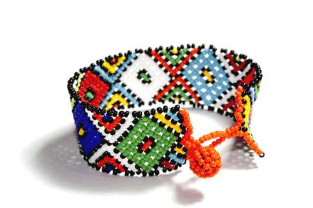 isolated single traditional brigh beadwork zulu bracelet photo