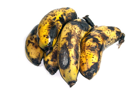 overripe: cluster of five spotted over-ripe bananas on white Stock Photo