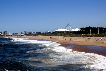 mabhida: View of Blue Lagoon Beach against city skyline in Durban South Africa
