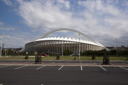 stadium  durban: DURBAN, SOUTH AFRICA - MARCH 4, 2014; Parking bays on beach front promenade in front of Moses Mabhida football stadium in Durban South Africa