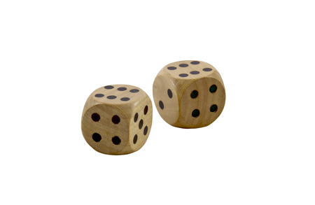 two wooden dice with black dots on white photo