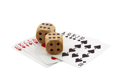 royal flushes in spades and hearts with wooden dice photo