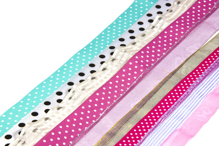 rows of textured spotted ribbons on white photo
