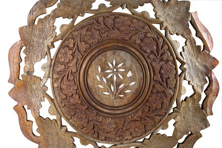 ornae pattern carved on wooden coffee table photo