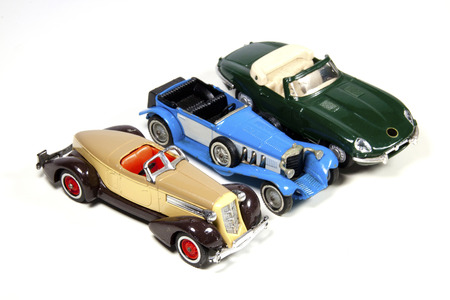 isolated collection of three toy model cars on white Banco de Imagens