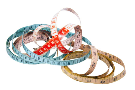centimetres: three tape measures marked in inches and centimetres