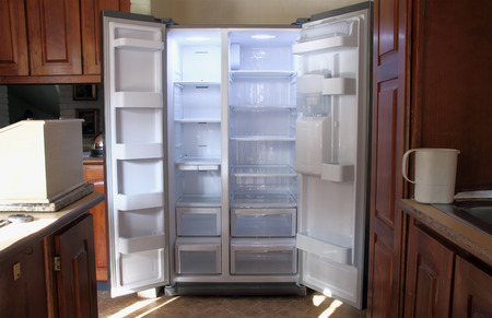 just unpacked new refrigerator with empty shelves photo