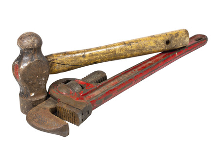 peen: well used monkey wrench and ball peen hammer