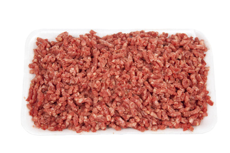 pound of raw ground beef on white plate photo