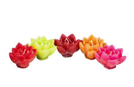minature: five minature candles in assorted bright colors Stock Photo
