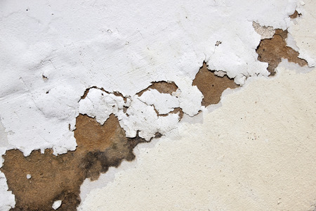 neglect: bubbling paint on exterior wall due to neglect and lack of maintenance