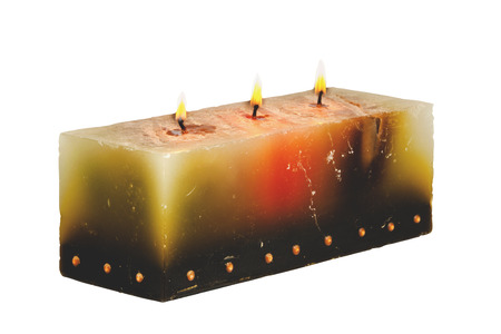 wicks: large rectangular candle with three burning wicks