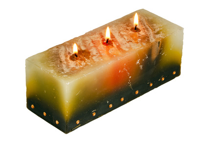 wicks: large rectangular candle with three lighted wicks