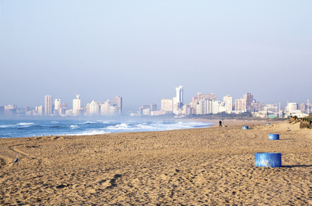 View of smoggy Durban city skyline from La Lucia beach in South Africa Banco de Imagens
