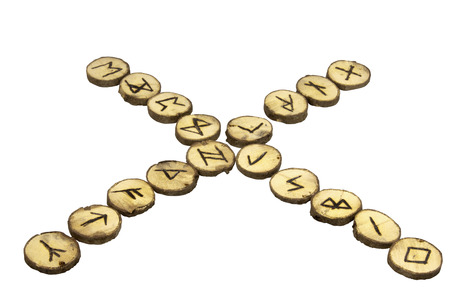 futhark: display of handmade runes in the shape of an X