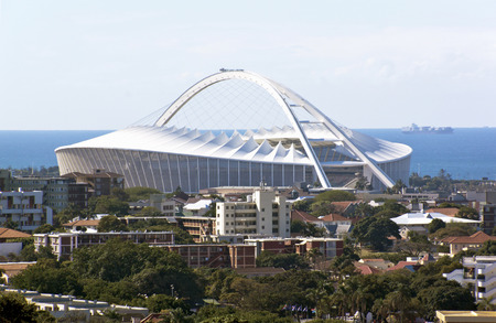 mabhida: DURBAN, SOUTH AFRICA - JULY 10, 2014: View of Moses Madhida Stadium and ocean in Durban, South Africa
