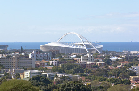 mabhida: DURBAN, SOUTH AFRICA - JULY 10, 2014: Moses Madhida Stadium Rises from urban landscape in Durban, South Africa