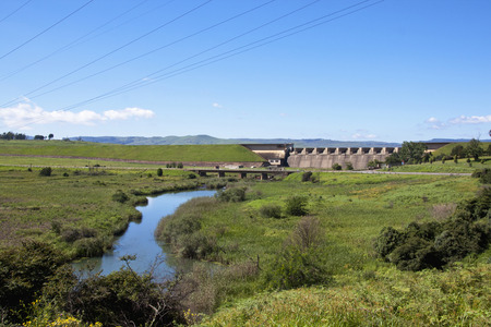 winding river below the wall of midmar dam, howick
