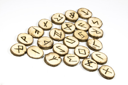 futhark: nordic symbols on collection of handmade wooden runes