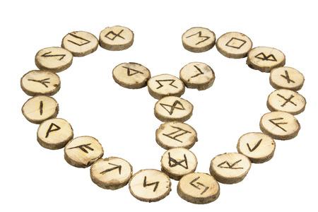 runes: arrangement of handmade wooden runes with Nordic Symbols