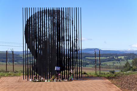 apartheid in south africa: Howick, KwaZulu-Natal, South Africa - 30 December 2013: Metal sculpture of Nelson Mandela at the site where he was arrested in 1962 by the apartheid government.