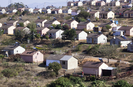 township: DURBAN, SOUTH AFRICA - JULY 21, 2014: View of low cost township houses fitted with solar heating at Verulam in Durban, South Africa