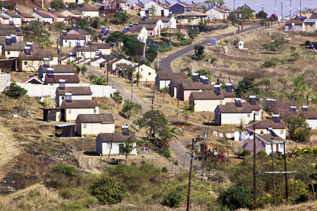 DURBAN, SOUTH AFRICA - JULY 23, 2014: Above view of Low cost township houses fitted with solar heating panels in Verulum in Durban, South Africa Editorial