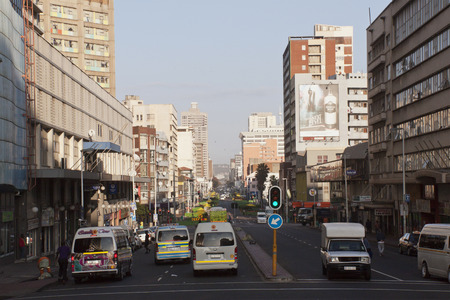 DURBAN, SOUTH AFRICA = August 17, 2014: Early morning view of vehicles and many people on West street in Durban South Africa Editorial