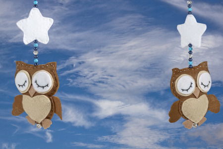 two sleeping felt owls on baby crib mobile photo