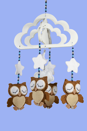 four felt owls on beaded baby cot mobile photo