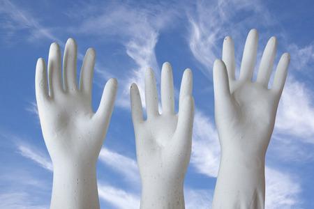 white molded plaster-of-paris hands reaching skyward