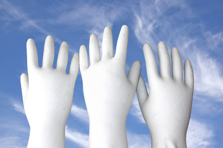 plaster of paris: white molded hands reaching to the sky
