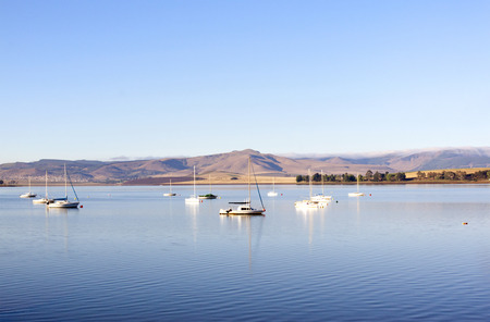 howick: yachts moored in a tranquil setting on the midmar dam